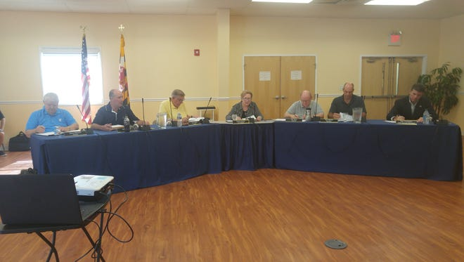 Ocean Pines board of directors and general manager at July 28 meeting