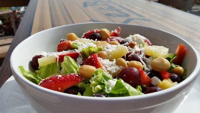 Seabreeze Island Grill and Raw Bar Narrows Fruit Salad includes macadamia nuts, feta cheese and coconut.