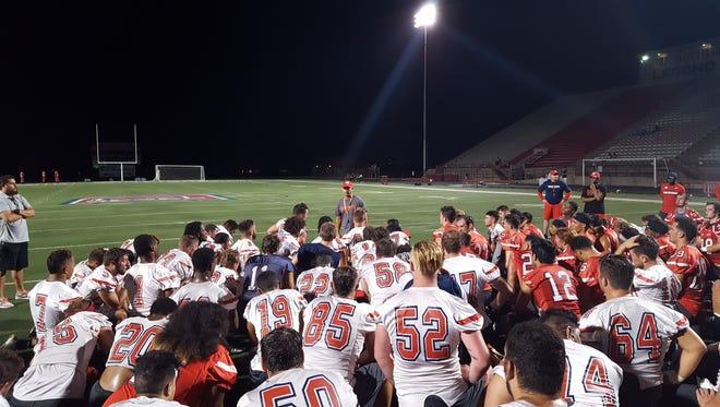 Dixie State head coach Shay McClure addresses the team after the first fall practice, Thursday, August 11, 2016.