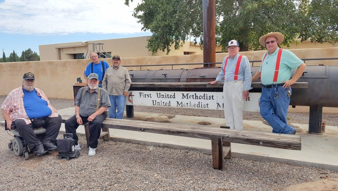 Members of the First United Methodist Church Men's group stand by the smoker they will use for the Duck Days BBQ on Saturday, Aug. 27.
