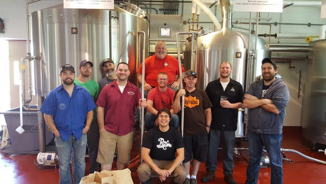 At back in the 585 Brewers Collaborative group is Dean Jones, Genesee Brew House. Middle, from left: Dan Western, Zack Hill, Lost Borough Brewing Co.; George Cline, Knucklehead Craft Brewing; Jeff Osborne, Stoneyard Brewing Co.; Josh Hunt, Roc Brewing Co.; Bruce Lish, Three Heads Brewing; Derek Armstrong, CB Craft Brewers; Ryan Brady, Genesee Brew House. Front: Nick Mesrobian, Roc Brewing Co.