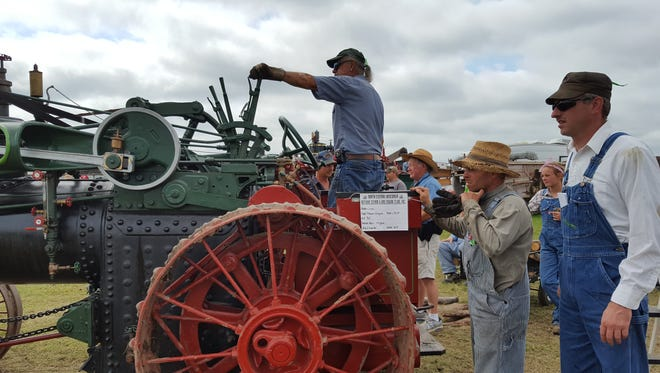 Onlookers and hobbyists prepare for a threshing demonstration with a 1909 steam engine at the North Central Wisconsin Antique & Gas Engine Show near Edgar on Aug. 28.