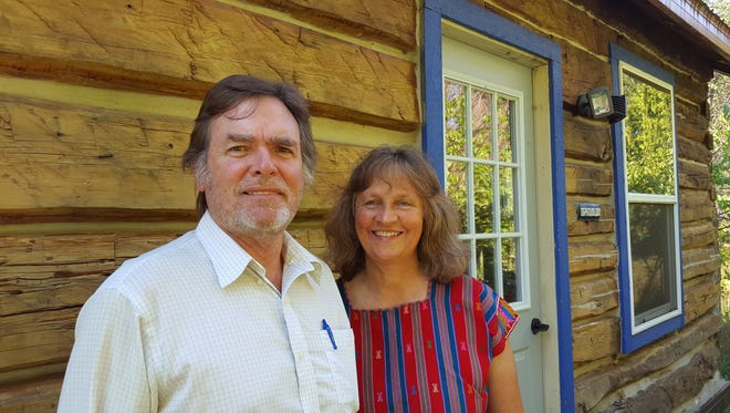 James and Krista Botsford pose for a photo outside a cabin on their Wausau property on Aug. 28, 2016.
