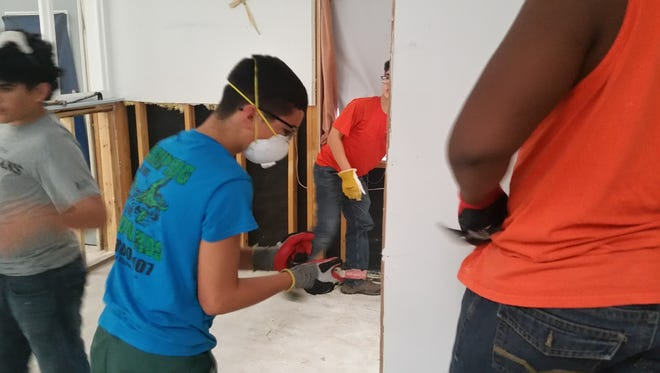 Members of Boy Scout Troop 107 from Lake Charles are helping strip houses in Crowley, La, as part of the Southern Region ReliefCorps.