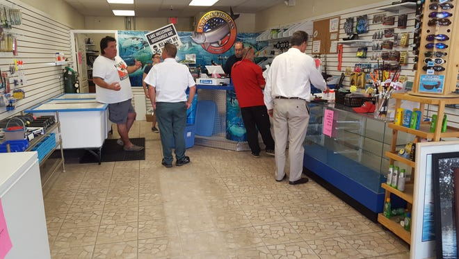 Customers at Tackle For Less in Stuart take advantage of reduced pricing for its inventory as the small bait shop prepares to close its doors this week.
