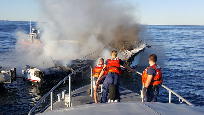 A Coast Guard Station Sandy Hook boat crew and New York Fire Department Marine Eight rescue crew responded to a boat fire near Sandy Hook, New Jersey Sept. 25, 2016. Coast Guard and FDNY crews arrived on scene where another boater had safely transferred eight people off the vessel in distress. (U.S. Coast Guard photo by Station Sandy Hook.)