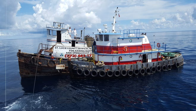 Tug Kathleen (left) is steadied by McCulley Marine's Tug Summer Star (right) Monday, Sept. 26, 2016 about 15 miles southeast of Fort Pierce Inlet an hour before  Tug Kathleen is deployed as St. Lucie County's newest artificial reef.