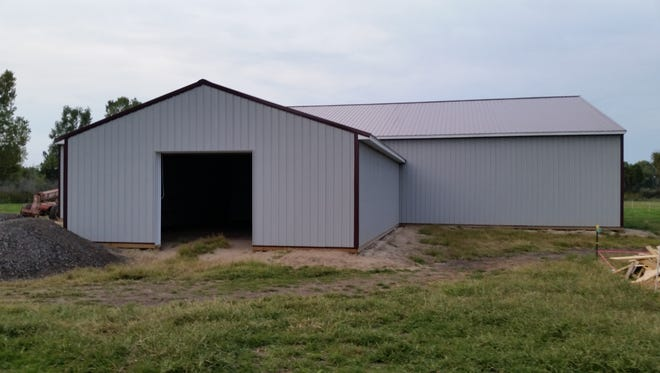 The almost-complete indoor riding arena will  be used to rehabilitate horses all year round at Day Dreams Farm.