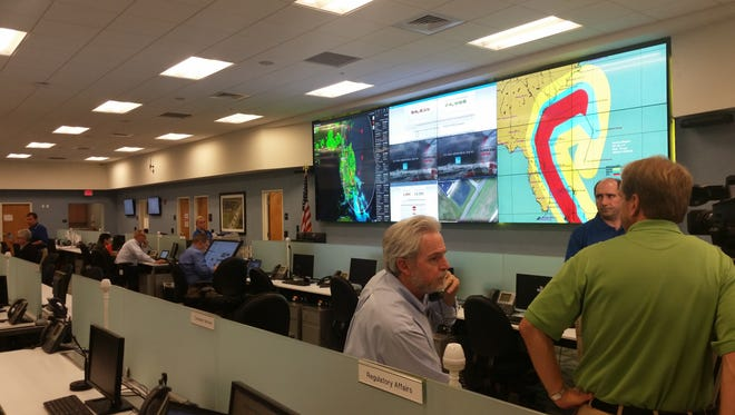 Florida Power & Light Co. officials monitor Hurricane Matthew at the company's Command Center in Palm Beach County.