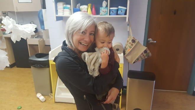 Leslie Snow picks up her grandson at day care, September 2016.
