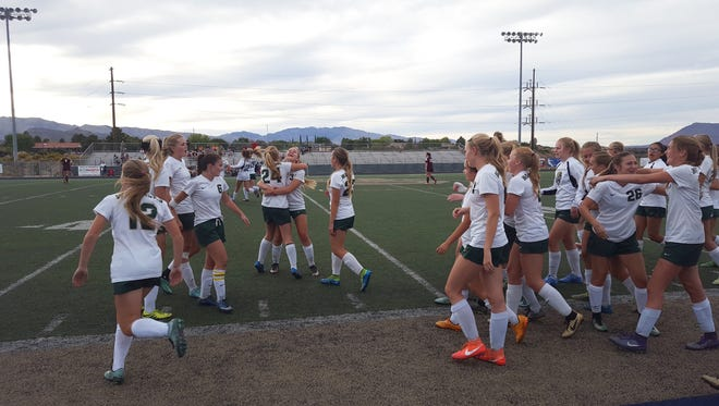 Snow Canyon players celebrate after beating Morgan in the first round of the state playoffs October 12, 2016.