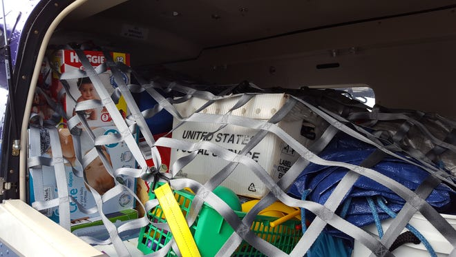 A Kodiak airplane sits nearly full of hurricane relief supplies prior to flying out to West End out of Witham Field in Stuart on Wednesday.