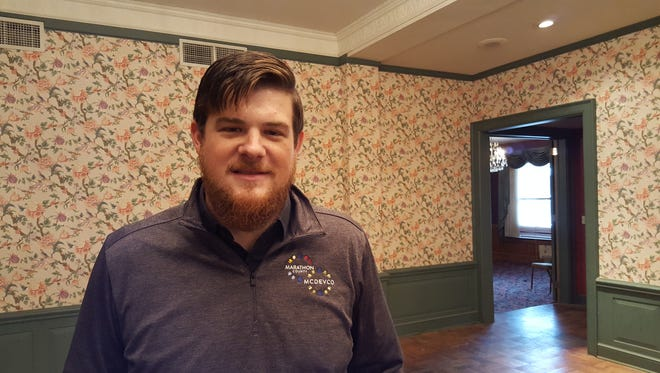 Nick O'Brien, community engagement specialist for MCDEVCO, poses for a photo in the Wausau Club Building on Oct. 12, 2016. O'Brien is coordinating the first Wausau SOUP program, which will raise funds for community projects.