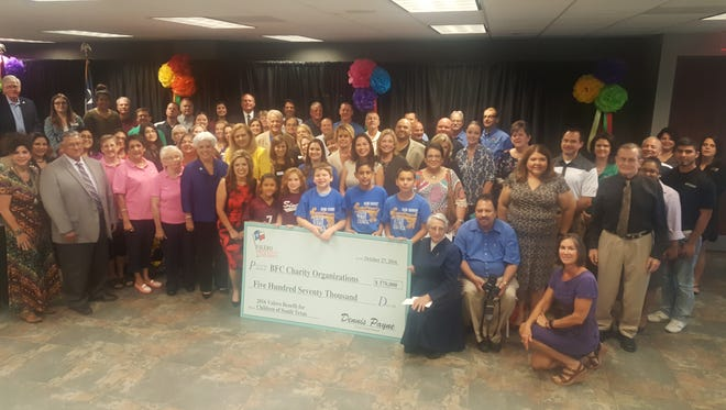 Representatives of 34 local charities pose with Valero representatives during the check presentation Thursday, Oct. 27, 2016, at Valero Bill Greehey Refineries offices..