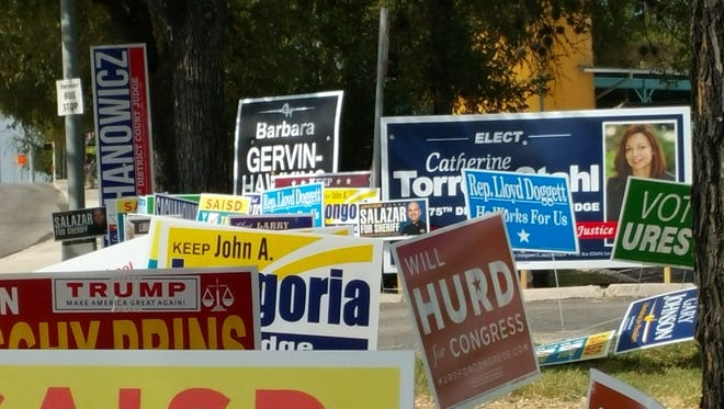 A sea of campaign signs outside a San Antonio polling place Friday. The western fringes of San Antonio and the Lower Valley in El Paso County will be crucial in the outcome of Texas' only competitive congressional race.
