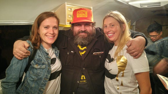 Amber Odhner (left) and Catelyn Augustine (right) with Creative Startups Competition guest speaker Aaron Draplin. Mr. Draplin is a graphic artist who designed the Obama logo and the National Recovery Act logo.