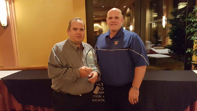 Waupun Fire Inspector Mike Beer, left,  and Waupun Fire Chief B.J. DeMaa. Beer was recently named Wisconsin Fire Inspector of the Year.