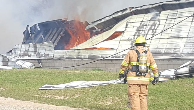 Fighting the fire was complicated by the fact there was a manure pit under the building.