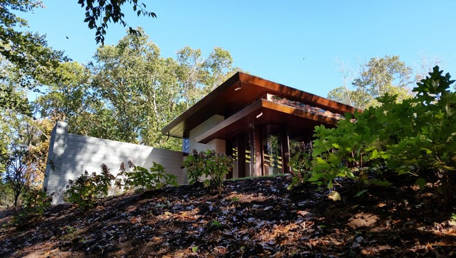 This Oct. 2, 2016 photo shows the Frank Lloyd Wright-designed Bachman-Wilson House as seen from the Crystal Bridges Museum of American Art in Bentonville, Ark. The museum moved the home to Arkansas from Millstone, N.J., and opened it to the public in 2015.