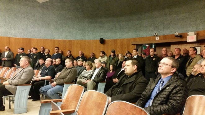 Area police and police supporters attended a December Wayne Township Council meeting in support of fired patrolman Erik Ferschman.