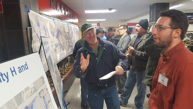 Resident John Hummer (left) and Department of Transportation engineer Rich Handrick talk about changing State 29 into a freeway at a Dec. 14, 2016, meeting.