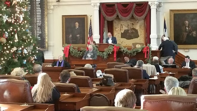 El Paso elector David Thackston stands at the podium during Texas' meeting of the Electoral College that elected Donald Trump president.