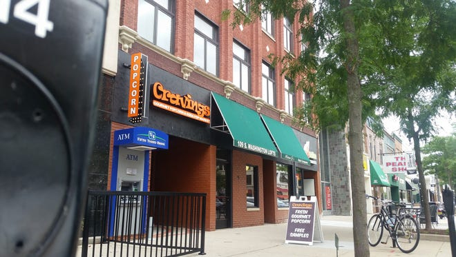 Exterior view of Cravings downtown location, 109 S. Washington Square.