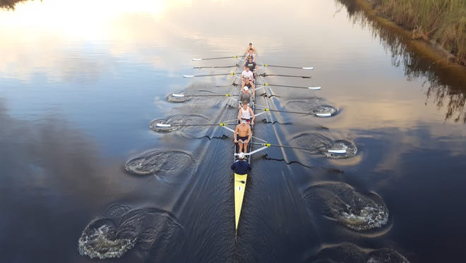 Yale University heavyweight eights crank out an afternoon workout last week on the C-54 Canal in Fellsmere.