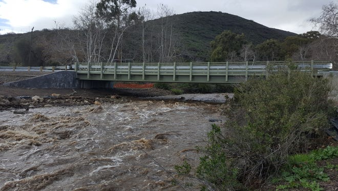 Creek rushes under a new bridge at Leo Carrillo State Park Friday morning.