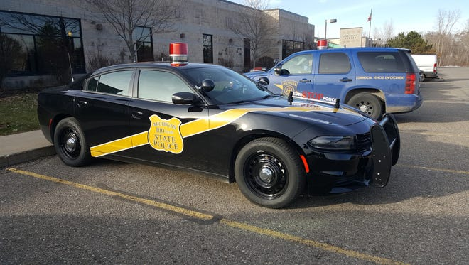The Michigan State Police's black and gold 2016 Dodge Charger, pictured here at the Livingston County Judicial Center in Howell, joined the department's patrol fleet in honor of the department's 100th anniversary.