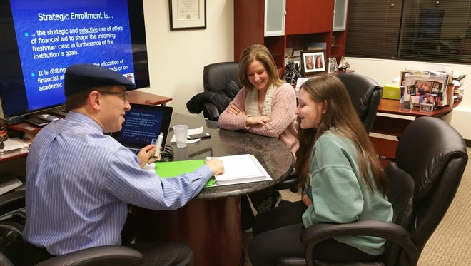 David Slater of College Benefits Research Group speaks with Barbara Salvador and her daughter Grace Giglio.