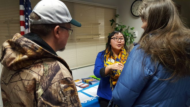 Ka Lia Smith (center), a financial aid adviser at the University of Wisconsin-Stevens Point, answers questions after a Degrees of Debt info night at the Marathon County Public Library in Wausau on Feb. 23, 2017.