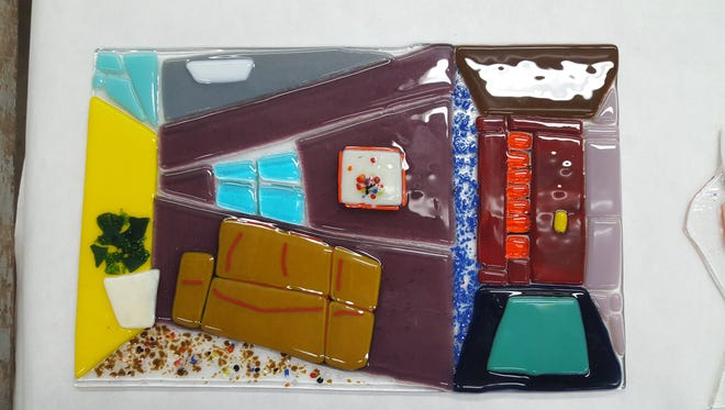 """Jonathan Orth, Neenah High School, was named a winner in the 2017 Fox Valley Area High School Glass Exhibit for his piece titled """"House"""" in the fused glass category."""