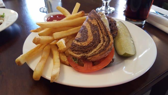 Tomato cheddar Swiss basil aioli panini on rye at the Washington Inn and Tavern.