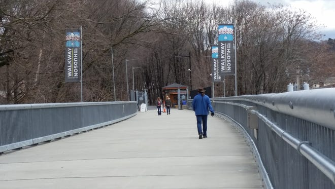 Walkers stroll across the Walkway Over the Hudson on Wednesday in Poughkeepsie.