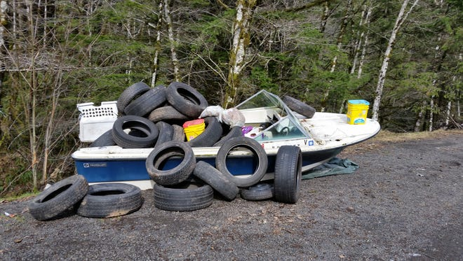 Oregon State Police tracked down the owner of this trash boat, abandoned by the Wilson River, despite all identifying marks having been scraped off.