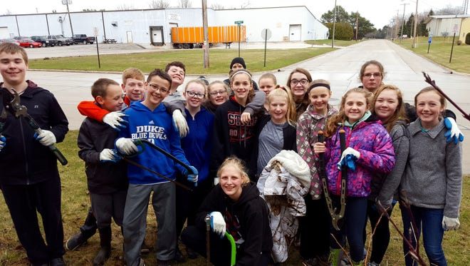 Mishicot Middle School students helped remove invasive honeysuckle from the forest at Woodland Dunes Nature Center & Preserve in Two Rivers.