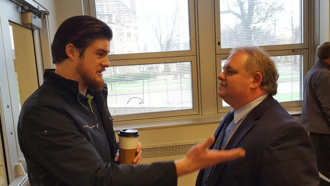 Wausau Mayor Robert Mielke (right) talks with Nick O'Brien, MCDEVCO community engagement specialist, after Mielke's first State of the City speech on April 20, 2017, in City Hall.
