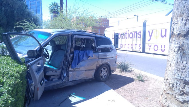 Police say a minivan drove into the path of a Valley Metro light rail train May 4, 2017, in downtown Phoenix. The minivan's driver was taken to a hospital.