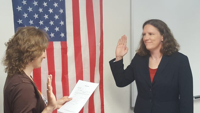 Kelly Hanink is sworn in as the first chief of the Riverside Fire District Monday in Schofield.