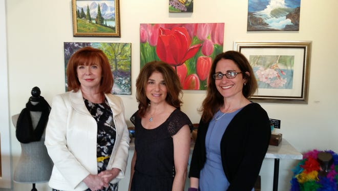 With the help of county and state funding, Sharon Reed (center) was able to turn the Garwood VFW building into South Avenue Arts, a gallery, studio, school and summer camp. She is pictured with Maureen Tinen (left), president of UCEDC, the county redevelopment corporation, and Melissa Orsen, CEO of the state Economic Development Authority.