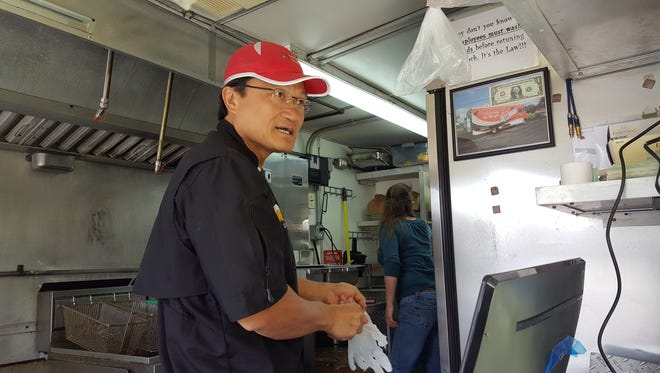 "Chef Tom Lin, a winner on Food Network's ""Cutthroat Kitchen,"" prepares tacos in his Fortune Cooking Food Truck Tuesday, June 6, 2017 as part of the Howell Main Street's Food Truck Tuesday. His food truck is one of a dozen trucks participating in Howell's Food Truck Rally May 19."