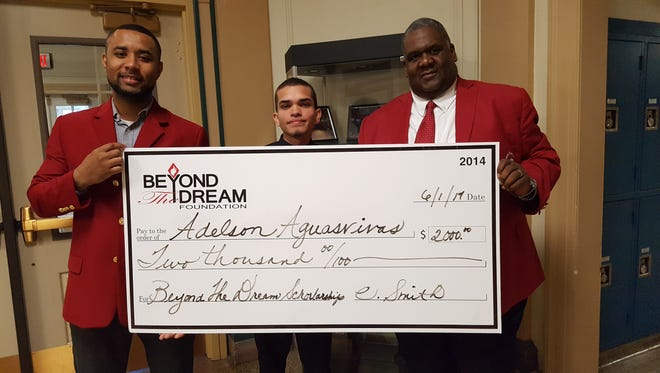 Scholarship Committee Chairman Siraj Bah, left to right, student Adelson Aquasvivas and fraternity President Timothy Hopkins are shown during the awards ceremony.