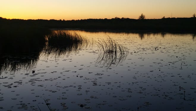 The sun sets over Mud Lake in the Cedarburg Bog