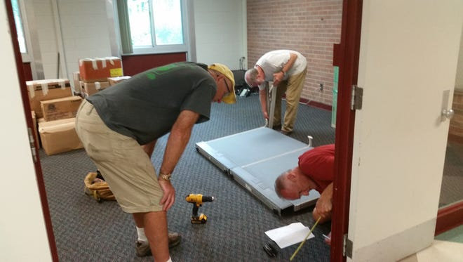 Volunteers work at Community Sharing's new location in Highland.