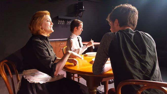 """From left, Gennie Adams, playing Elizabeth Gould, Brandon Eck, playing Rodman Gould and Kole Patterson, playing Hank Gould, during a rehearsal for """"Return to Values."""" The play looks at what happens when the country is forced to return to the values of the 1950s."""