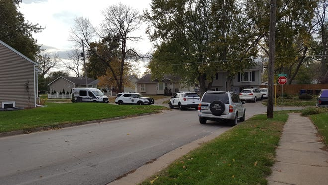 Des Moines police on the scene of a reported shootout at Garfield Avenue and Hutton Street on Thursday, October 26, 2017.