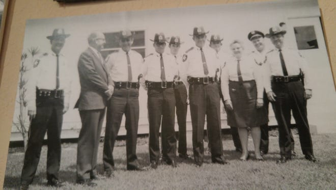 In 1971, the police department had 11 sworn officers, the police chief's secretary, four dispatchers and four school crossing guards.