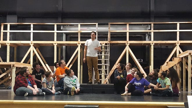 "A.J. Mendini (center) portrays Jesus during a cast rehearsal for Cumberland County College's production of ""Godspell,"" which opens Nov. 16."