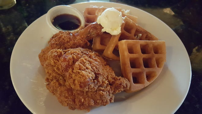 The Chicken and Waffles ($12) served with a side of red chile syrup at St. Clair Winery and Bistro in Las Cruces during breakfast hours.